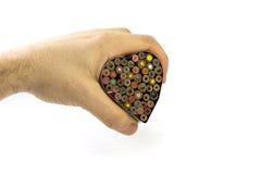 Mãos que prendem o coração Fotografia de Stock