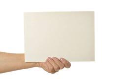Mãos que prendem o papel em branco Imagens de Stock