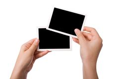 Mãos que prendem uma fotografia Imagem de Stock