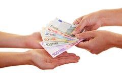 Mãos que reivindicam o dinheiro europeu Fotografia de Stock Royalty Free