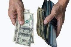 Mãos que removem o dinheiro da bolsa foto de stock royalty free