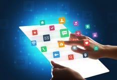 Mãos que tocam em uma tabuleta transparente com ícones coloridos Fotografia de Stock Royalty Free