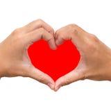 Mãos sob a forma do coração vermelho Fotografia de Stock