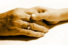Mãos unidas de novo e de velho Foto de Stock Royalty Free