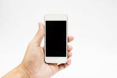 Mãos usando o telefone de pilha Fotografia de Stock Royalty Free