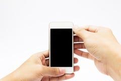 Mãos usando o telefone de pilha Foto de Stock