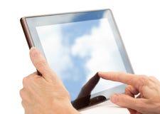 Mãos usando um computador da tabuleta isolado no branco fotos de stock