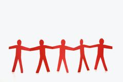 Mãos vermelhas da terra arrendada dos povos Foto de Stock