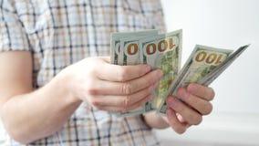 Mężczyzna liczy USA dolary Biznes, duży pieniądze sukcesu pojęcie zbiory