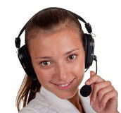 Mädchen über einen Speakerphone Stockbild