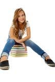 Mädchen auf Büchern Lizenzfreie Stockbilder