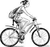 Mädchen auf dem Fahrrad Lizenzfreies Stockfoto