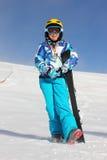 Mädchen auf dem Schnee mit Medaille Lizenzfreie Stockfotografie