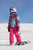 Mädchen auf dem Schnee mit Medaille Stockbilder