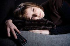Mädchen auf einem Sofa Lizenzfreies Stockbild