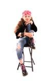 Mädchen auf einem Stuhl Lizenzfreie Stockbilder