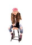 Mädchen auf einem Stuhl Stockbilder