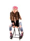Mädchen auf einem Stuhl Lizenzfreies Stockbild
