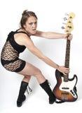 Mädchen auf Felsengitarre Lizenzfreies Stockbild