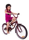 Mädchen auf ihrem Fahrrad Lizenzfreie Stockfotografie