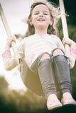 Mädchen auf Schwingen Stockbilder