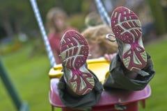 Mädchen auf Schwingen Lizenzfreie Stockfotos