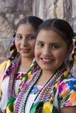 Mädchen auf traditionellen Kostümen Stockbilder