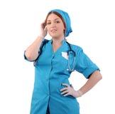 Mädchen bearbeitet als Krankenschwester Stockbild