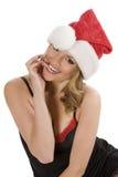 Mädchen beim Weihnachtsmannbeißen Stockfotografie
