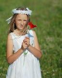 Mädchen betriebsbereit zur ersten heiligen Kommunion Stockbild