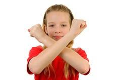 Mädchen bildet x-Zeichen Stockbilder
