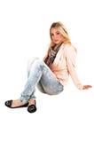 Mädchen, das auf Boden sitzt. Stockfotos