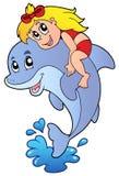 Mädchen, das auf Delphin sitzt Stockfotos