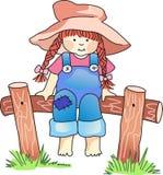 Mädchen, das auf Zaun sitzt Stockfoto