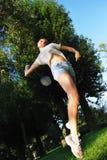 Mädchen, das Badminton spielt Stockbilder