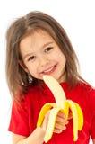 Mädchen, das Banane isst lizenzfreie stockfotos