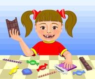 Mädchen, das Bonbons isst Stockfoto