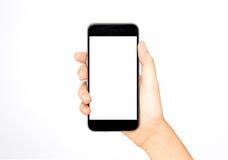 Mädchen, das in der Hand intelligentes Telefon hält Stockfotos