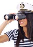 Mädchen, das durch Binokel schaut Stockbilder