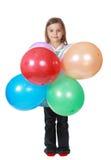 Mädchen, das ein Bündel Ballone anhält lizenzfreies stockfoto