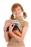 Mädchen, das ein Buch anhält Stockbild