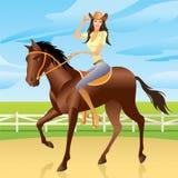 Mädchen, das ein Pferd in der westlichen Art reitet Stockbild