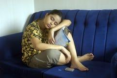 Mädchen, das ein Schlaefchen hält Lizenzfreie Stockfotos