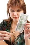 Mädchen, das eine Banknote brennt Lizenzfreie Stockfotografie