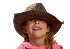 Mädchen, das einen braunen Strohhut trägt Lizenzfreies Stockfoto
