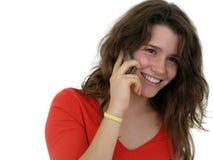Mädchen, das einen Handy verwendet lizenzfreie stockbilder