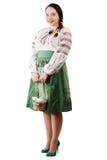 Mädchen, das einen Korb mit Eiern und Pasco hält Lizenzfreies Stockbild