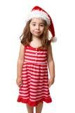 Mädchen, das einen Sankt-Hut zur Weihnachtszeit trägt lizenzfreies stockfoto