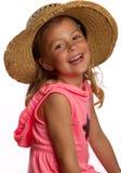 Mädchen, das einen Strohhut trägt Stockbilder