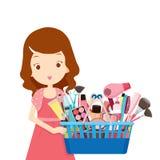 Mädchen, das Einkaufskörbe voll von den Produkten hält Lizenzfreie Stockbilder